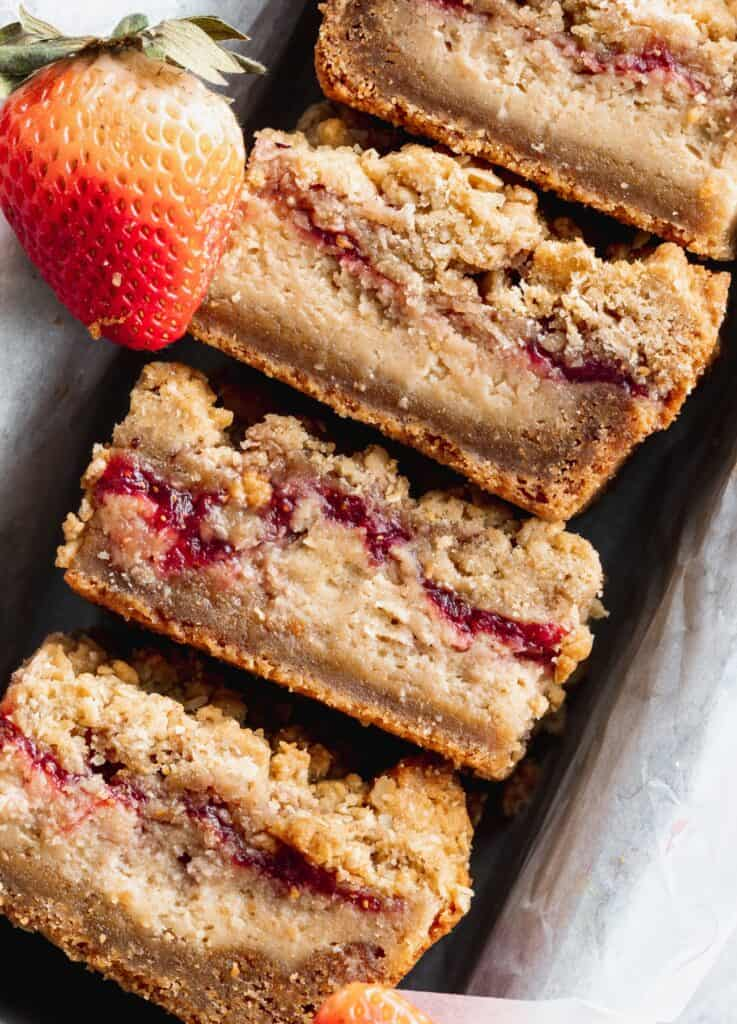 Close up of peanut butter and jelly cheesecake bars