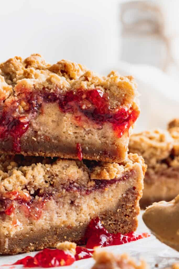 Stacks of peanut butter and jelly cheesecake bars
