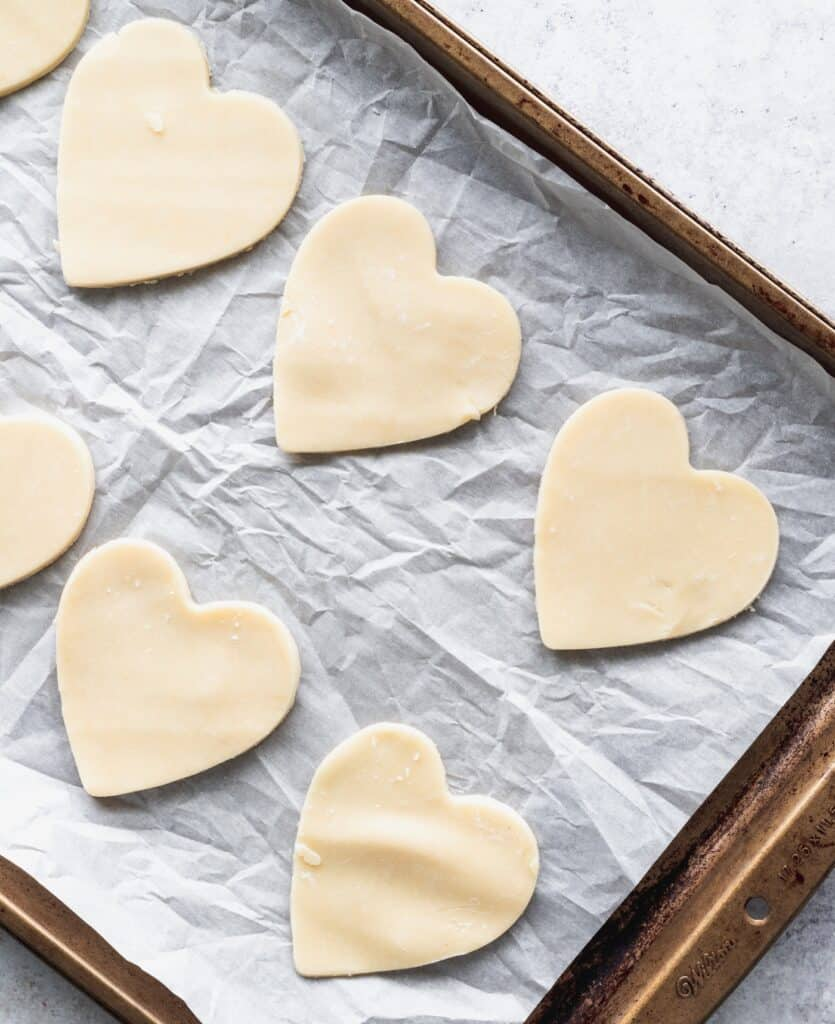 Pie hearts on a cookie sheet.