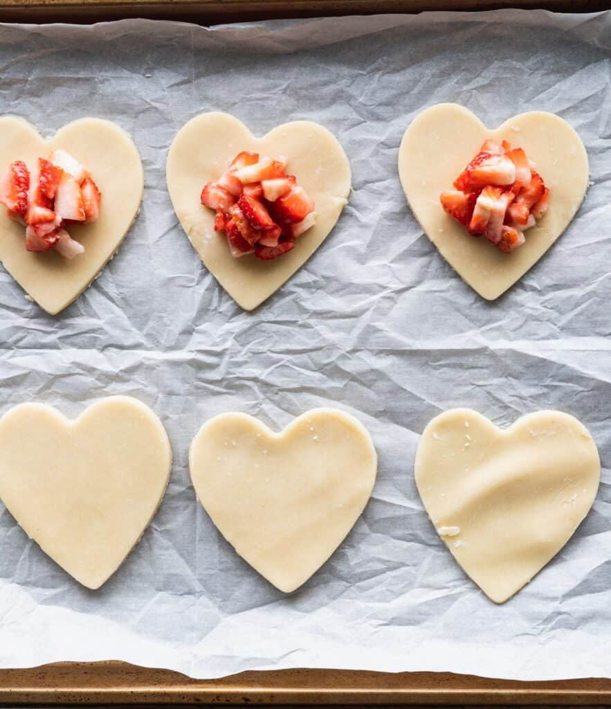 Pie hearts with strawberry filling.