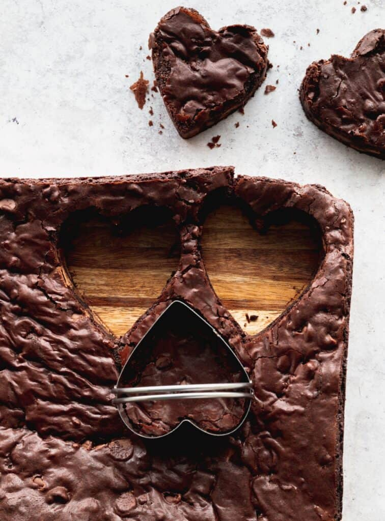 Cutting out hearts in the brownies.
