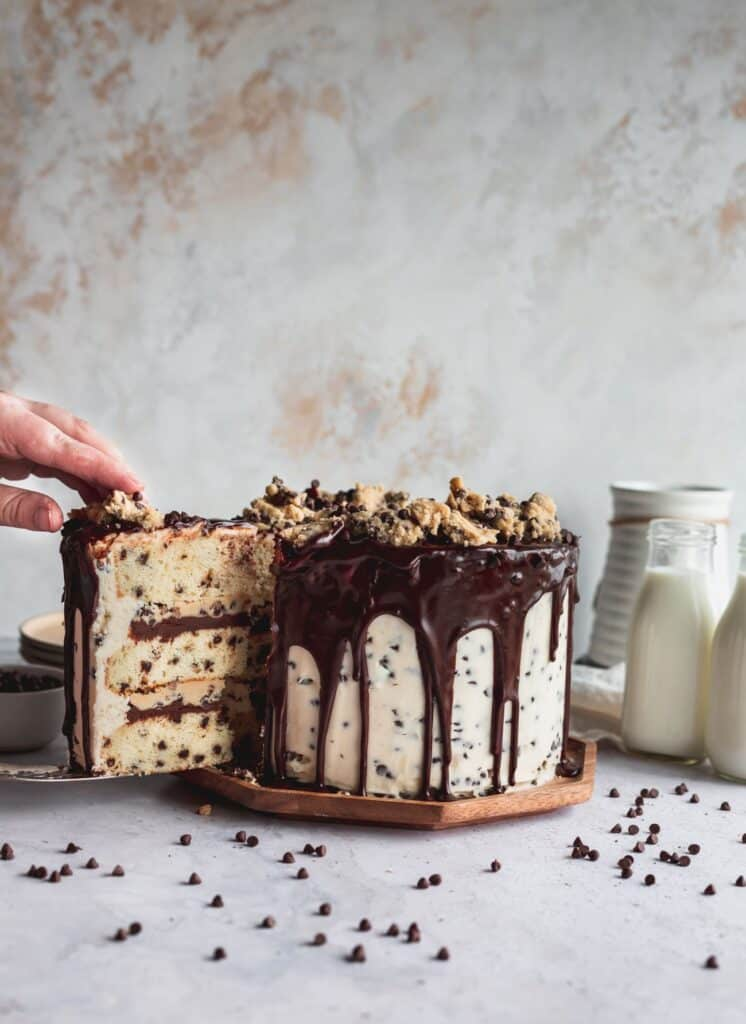 Taking a slice out of cookie dough cake.