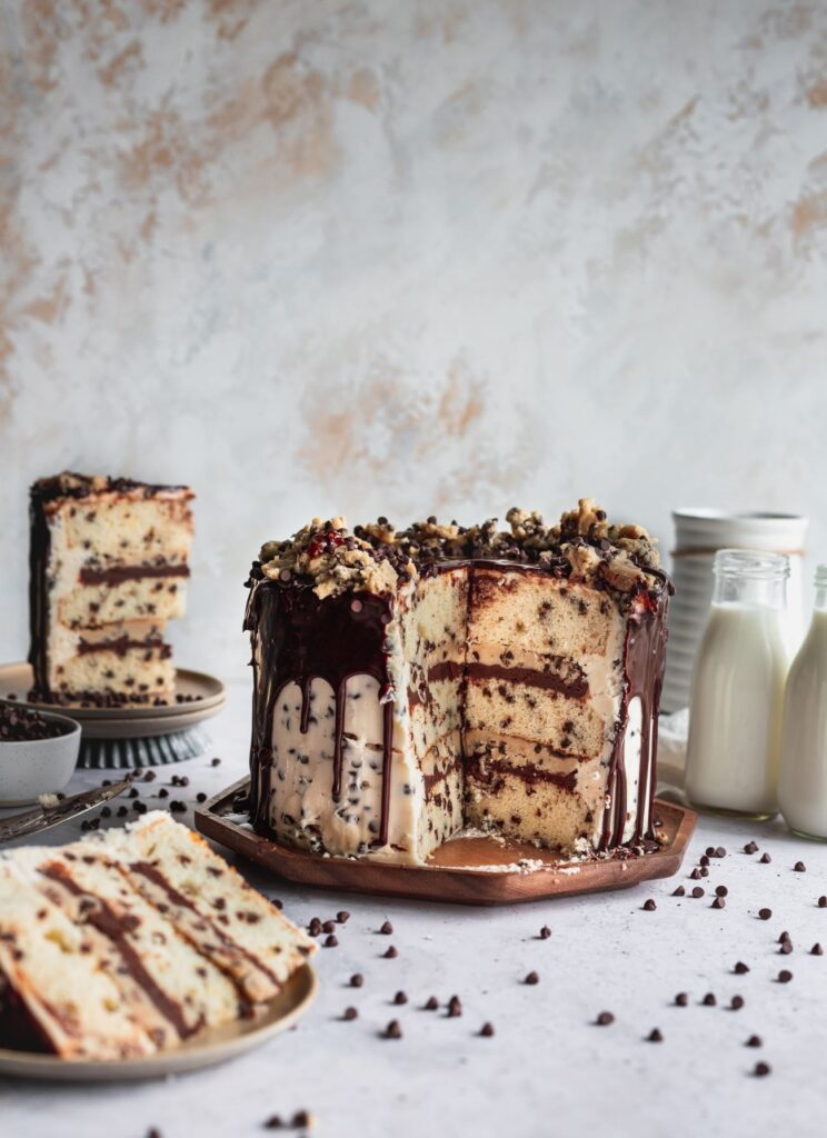 Slices missing from cookie dough cake.