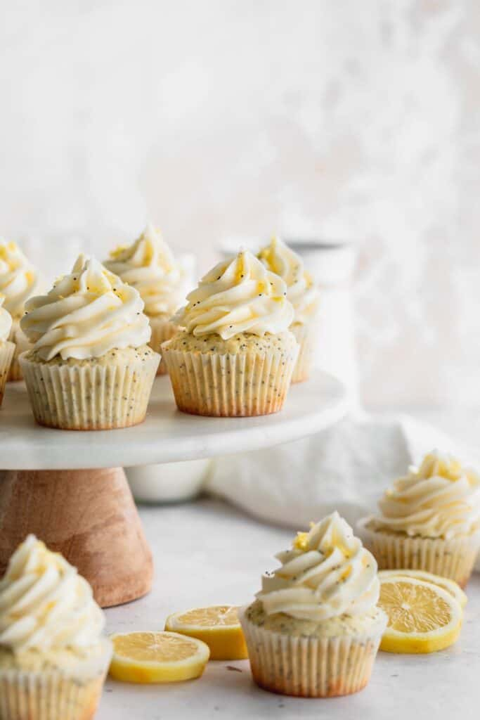 Lemon poppy seed cupcakes on a cake stand.