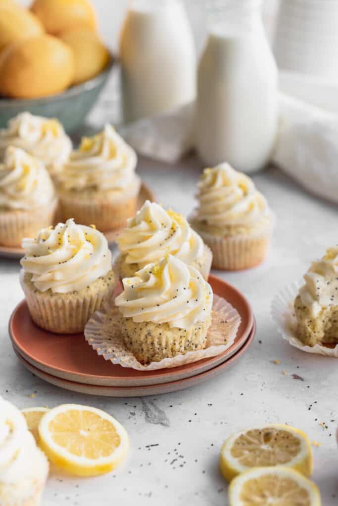 Lemon poppy seed cupcakes on a pink plate.