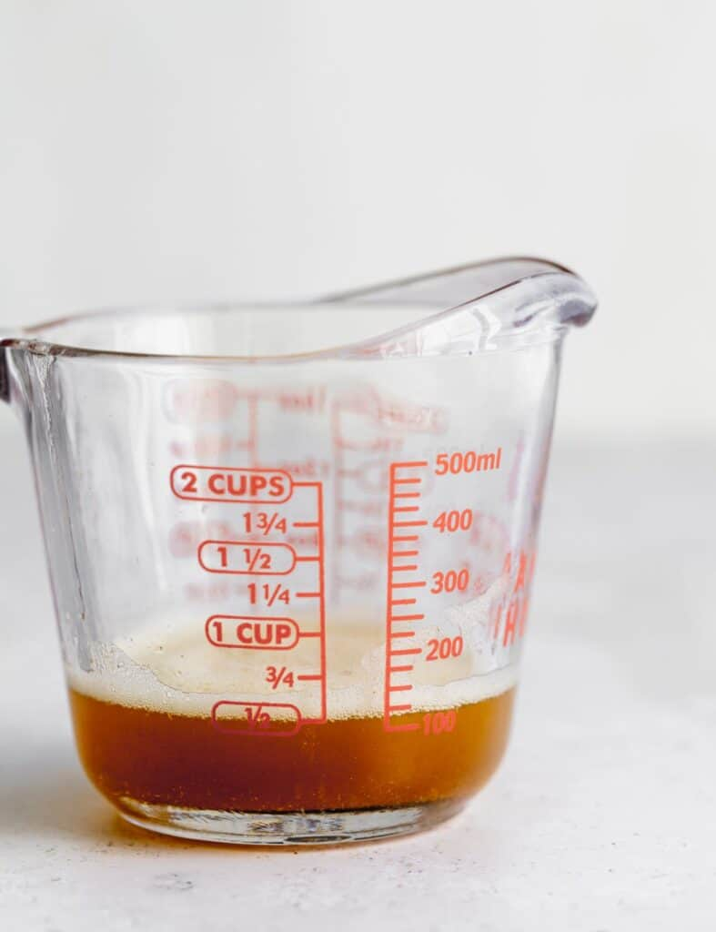 Brown butter in glass measuring cup.
