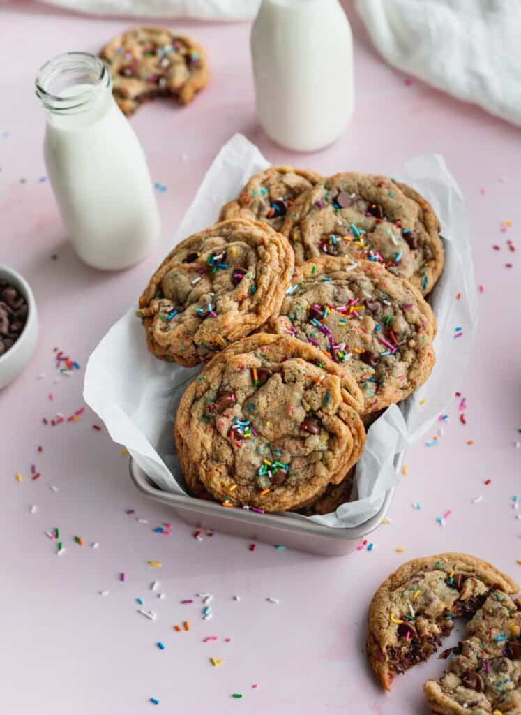 Sprinkle chocolate chip cookies in a tin.