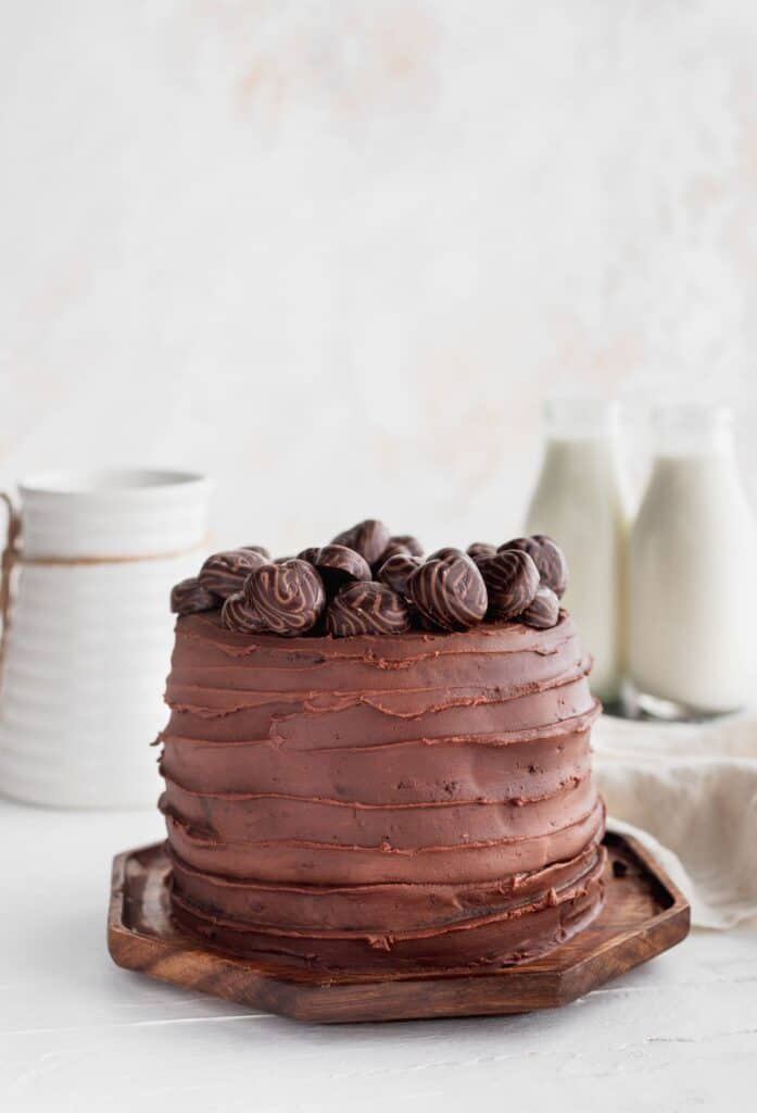 Mini chocolate cake on a wood board.