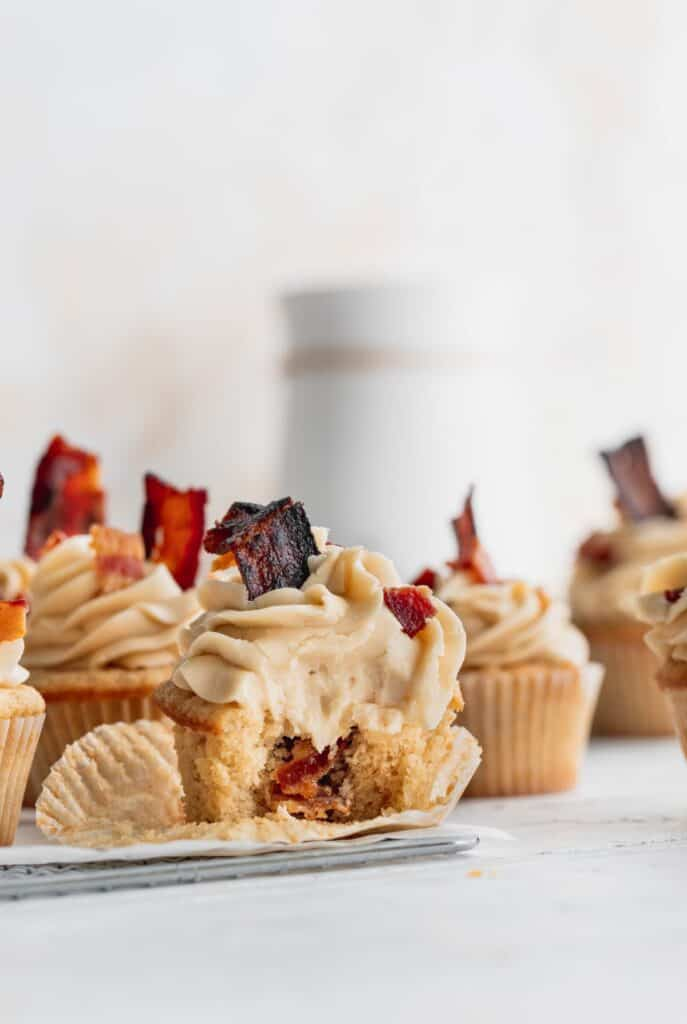 Bite missing from maple bacon cupcakes.
