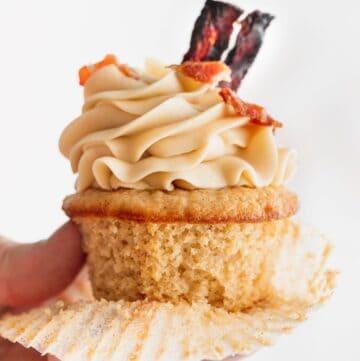 Holding a maple bacon cupcake.
