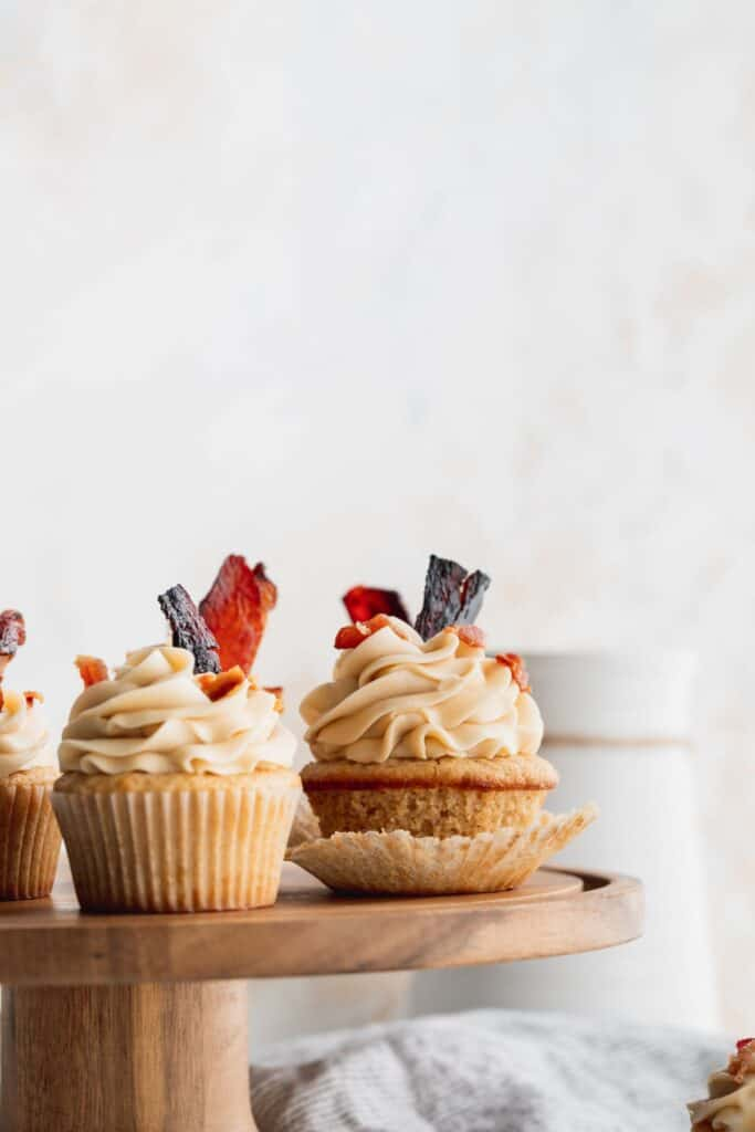Maple bacon cupcakes on a cake stand.
