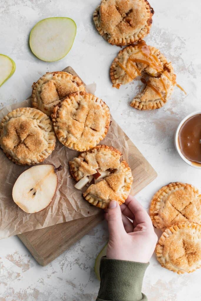 Butterscotch pear turnovers on a cutting board.