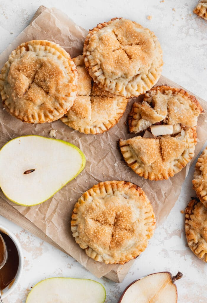 Pies on a cutting board.