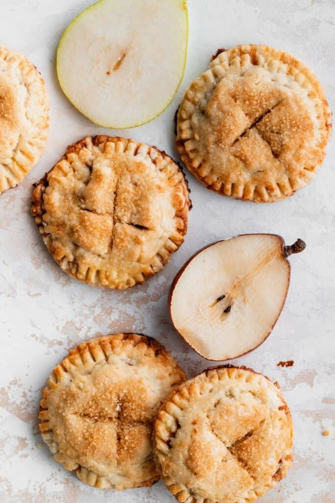 Butterscotch pear turnovers with pear halves.