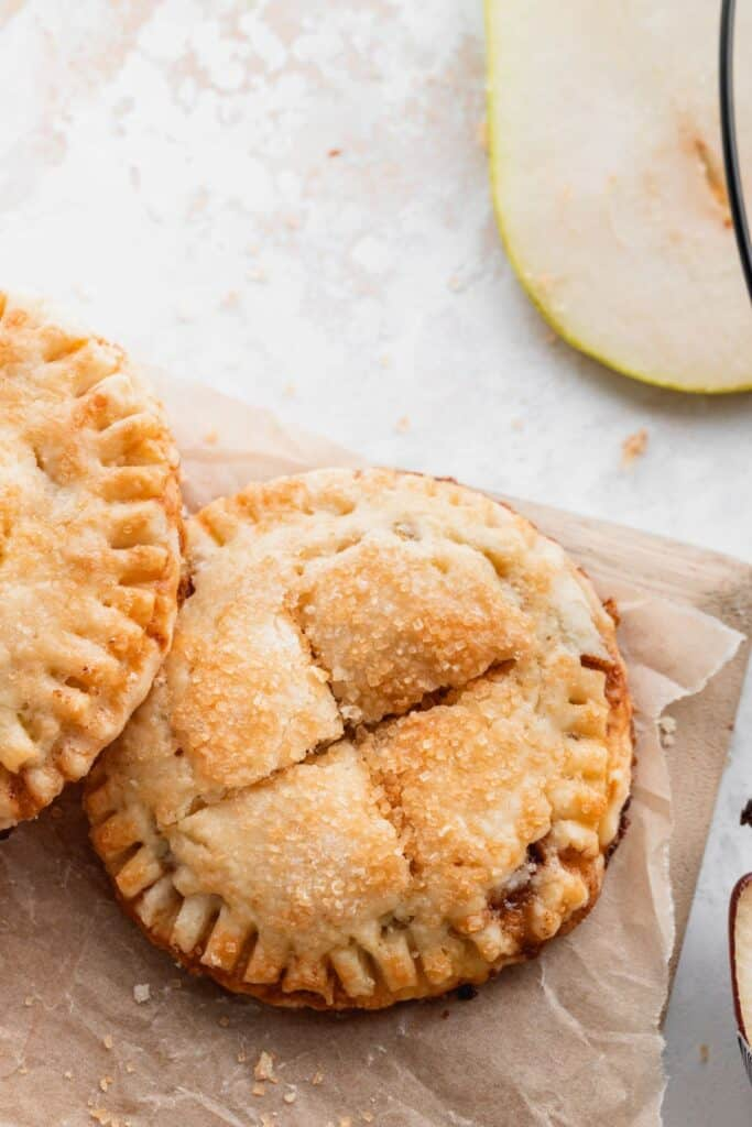 Butterscotch pear turnovers on a wood board.