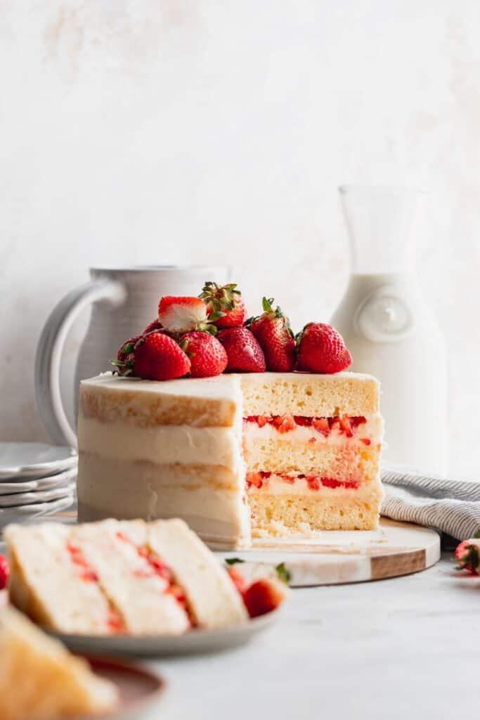 Cake slices missing on strawberry semi-naked cake.