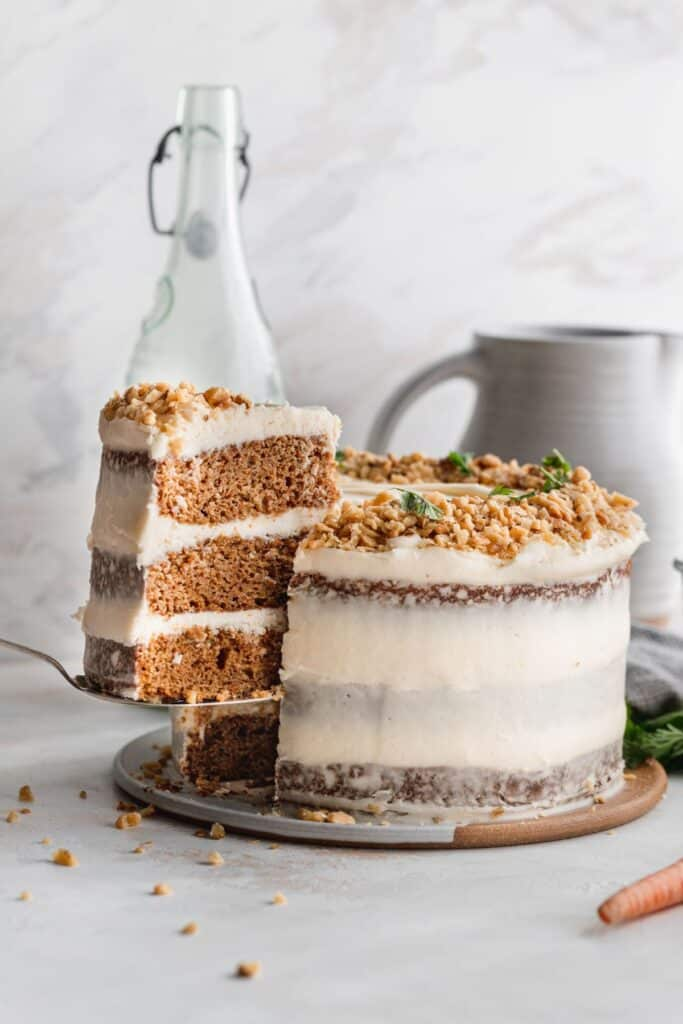 Pulling a slice out of brown butter carrot cake.