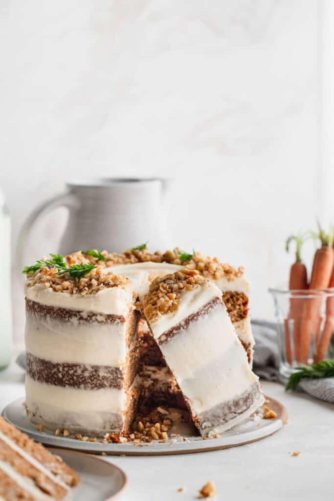 Brown butter carrot cake with a piece on its side.