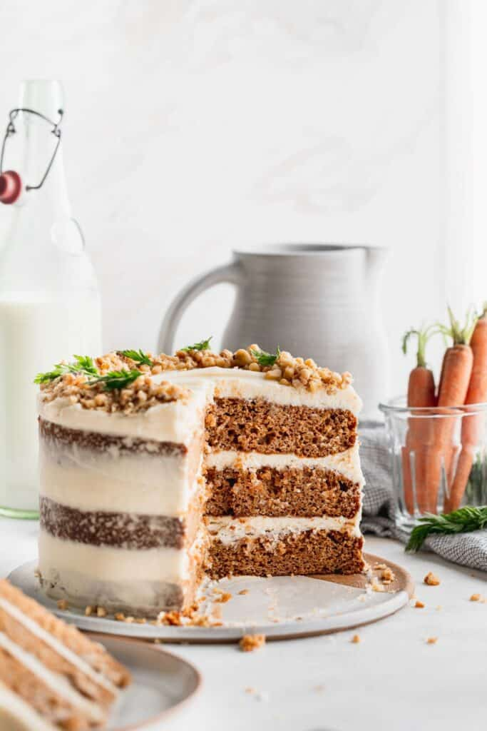 Brown butter carrot cake on a wood stand.