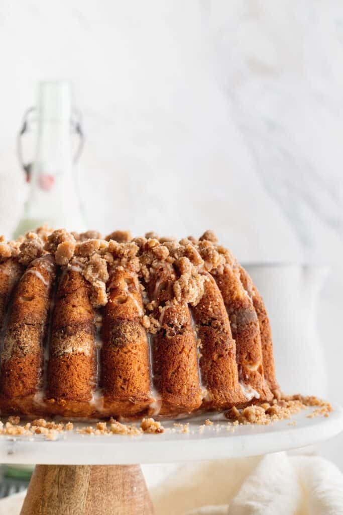 Banana bread coffee cake on a cake stand.