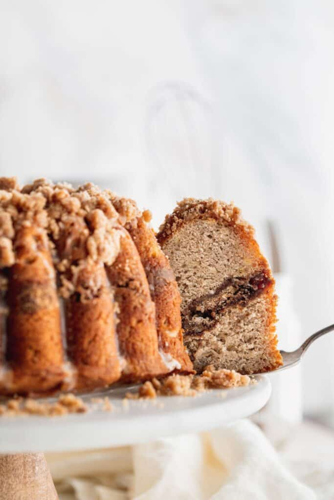Pulling a slice from banana bread coffee cake.