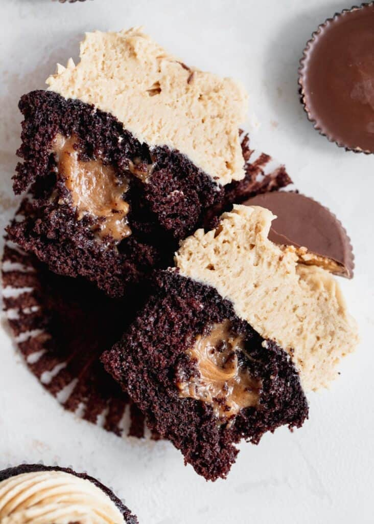 Peanut butter chocolate cupcakes split in half to see filling.