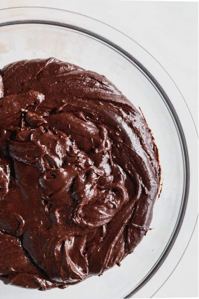 Brownie batter in glass bowl.