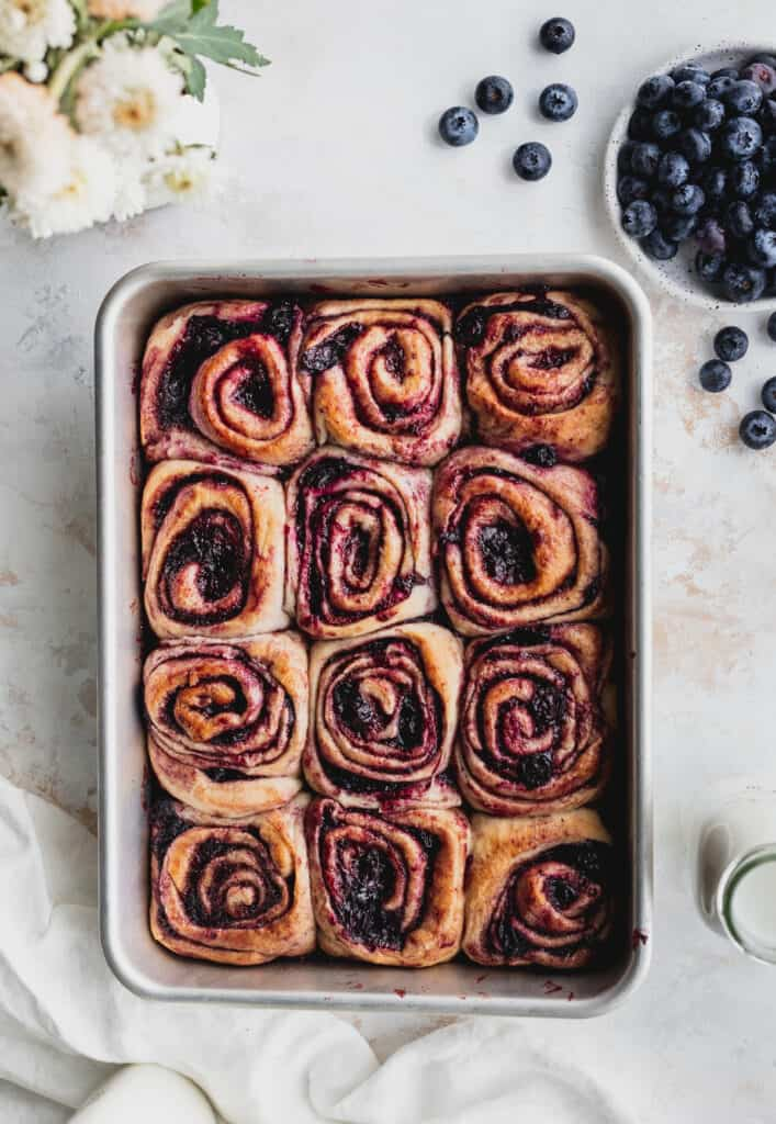 Blueberry cinnamon rolls with no frosting in the pan.