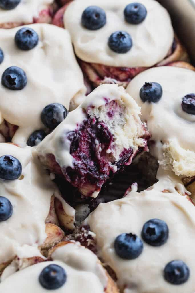 Cinnamon roll on the side to show the blueberry preserves.