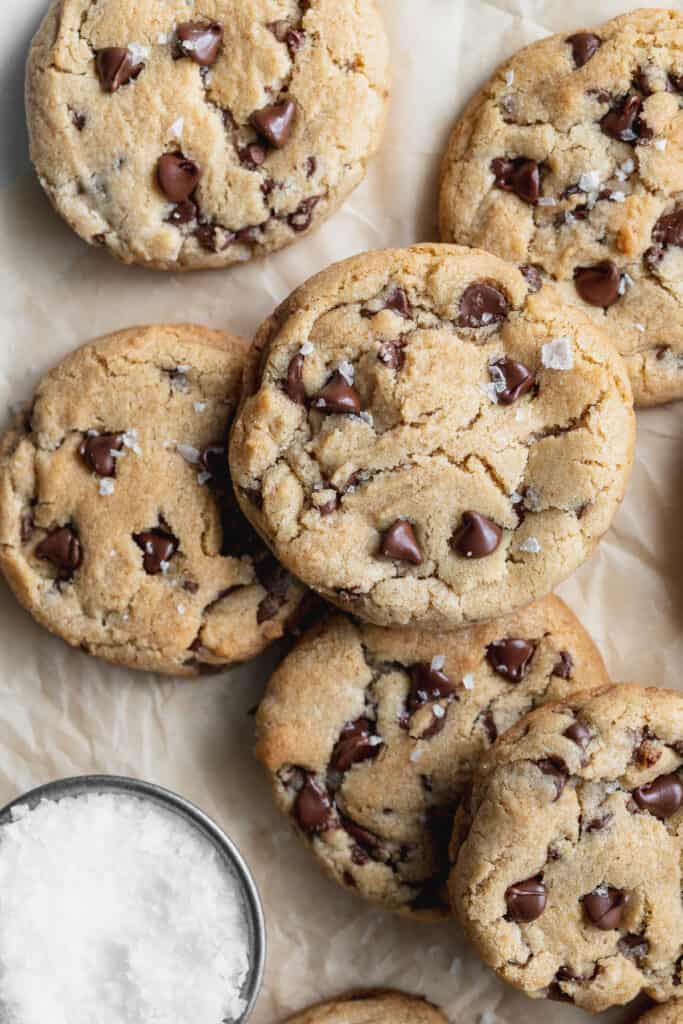 Brown butter chocolate chip cookies spread out.