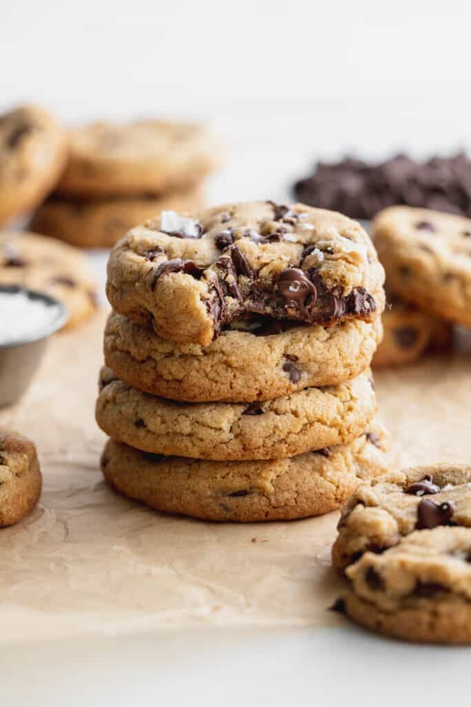 Stack of cookies with 1 missing a bite.