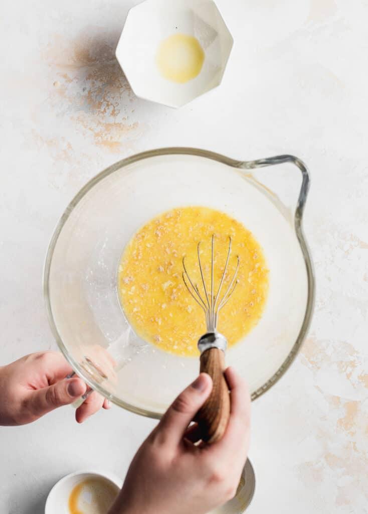 Stirring wet ingredients in bowl.