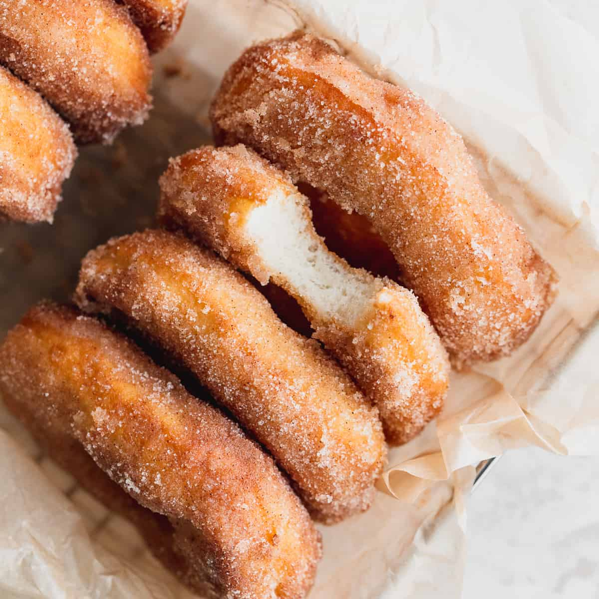 Close up of cinnamon sugar doughnuts in a basket.