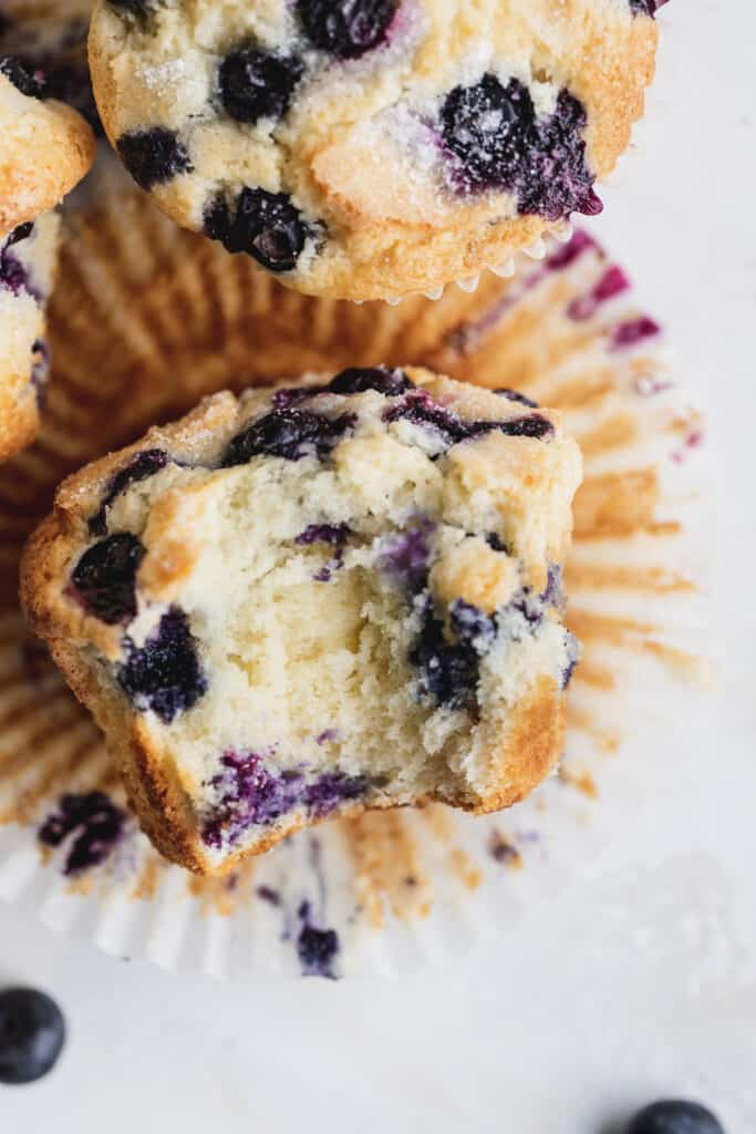 Top view of jumbo blueberry muffin missing a bite.