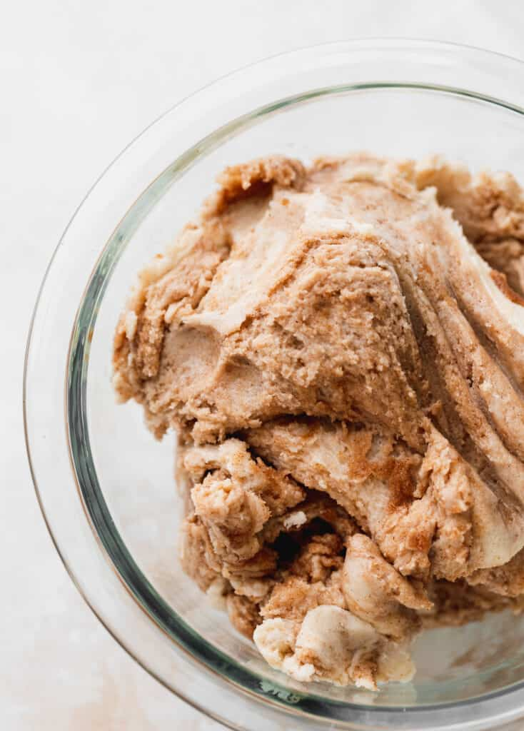 Snickerdoodle cookie dough in glass bowl.