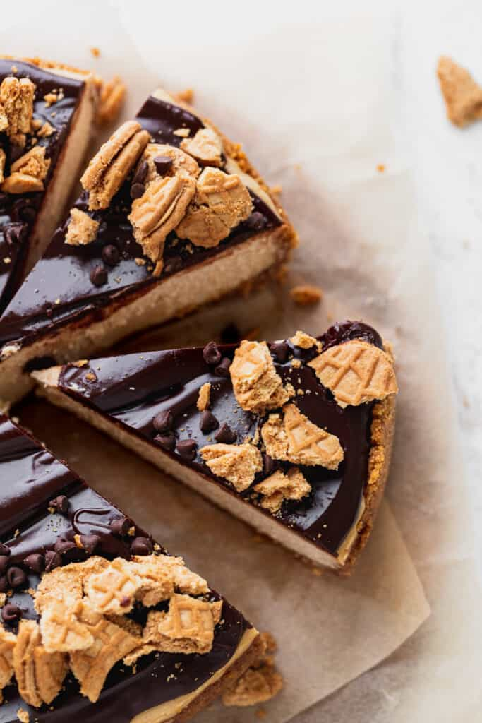 This peanut butter cheesecake cut into slices with one pulled away.