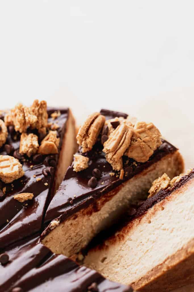Close up of slice of peanut butter cheesecake.