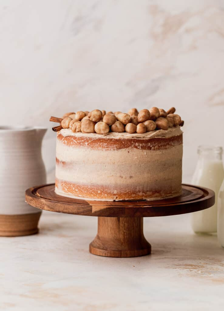 Snickerdoodle cake on a cake stand.