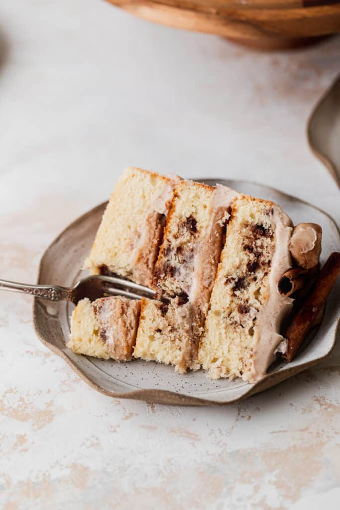 Snickerdoodle cake slice with fork inserted.