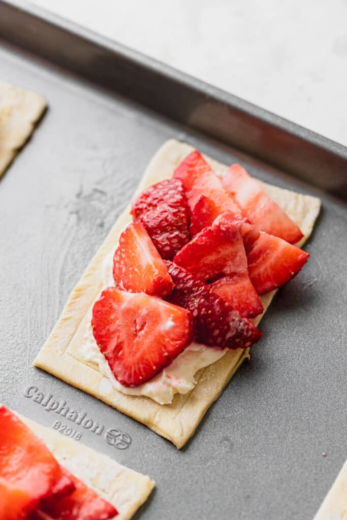 Strawberries on top of pastry.