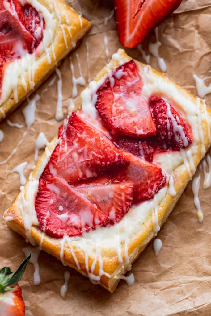 Strawberry danish close up with drizzle on top.