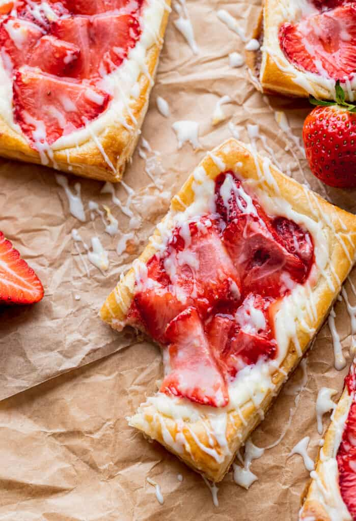 A bite missing with strawberries around it.
