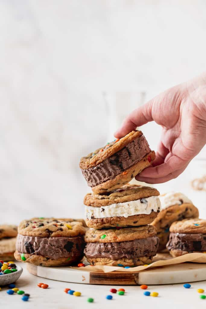 Lifting cookie up with hand.