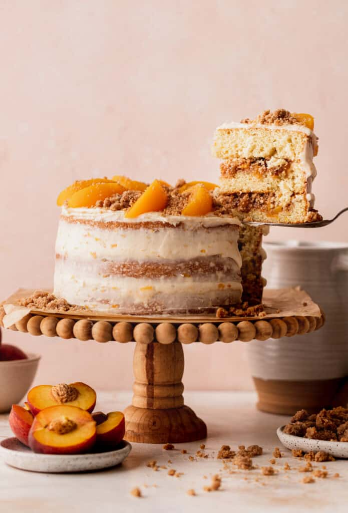 Taking a slice out of peach cake.
