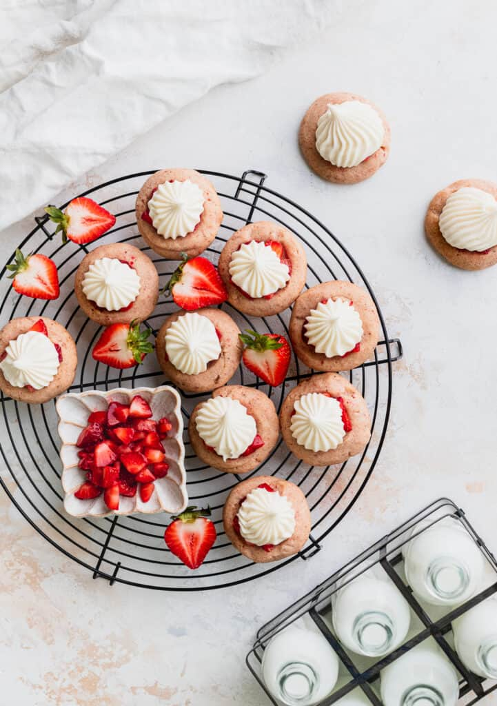 Strawberry cheesecake cookies on a wire rack.