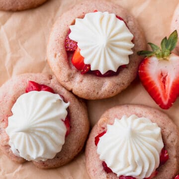 Strawberry cheesecake cookies on parchment paper.