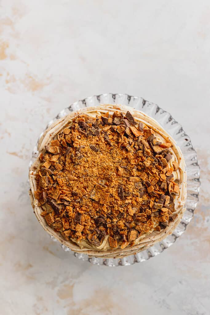 Chopped butterfingers on cake.