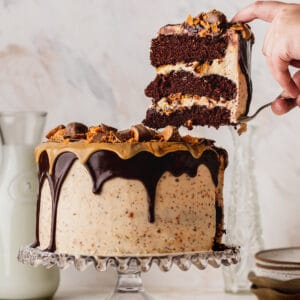 Butterfinger cake with a slice missing.