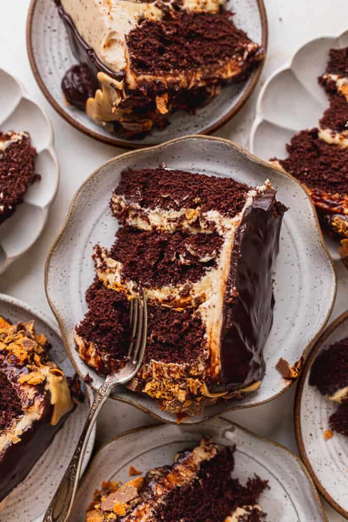 Butterfinger cake slice on multiple plates.