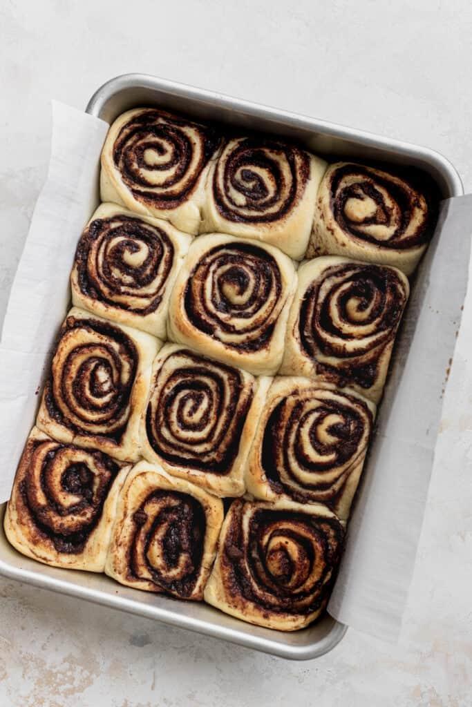 Baked cinnamon rolls in a pan.